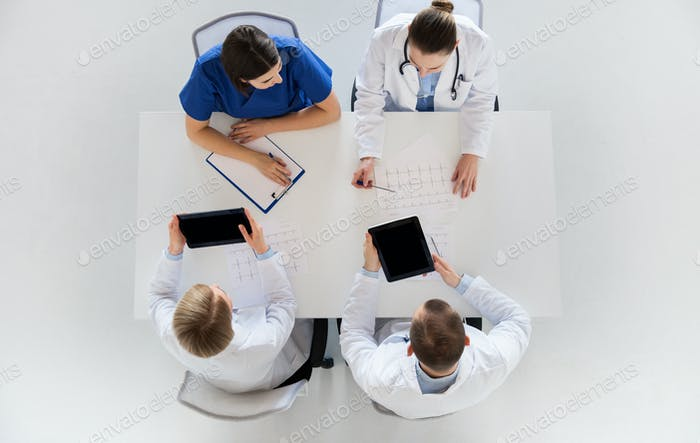 doctors with cardiogram and tablet pc at hospital