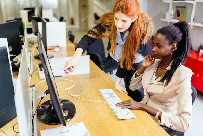 Businesswoman supervising employee