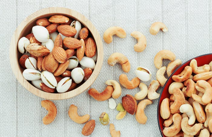 Cashew and almonds on tablecloth