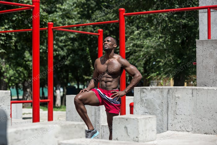 Athlete doing exercises at stadium