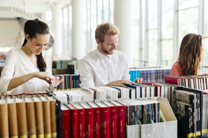 Group of students studying in library
