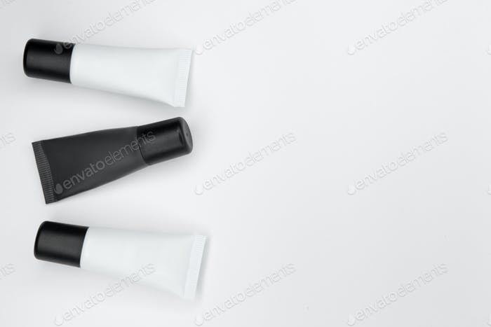 Tubes with cosmetics on a white background