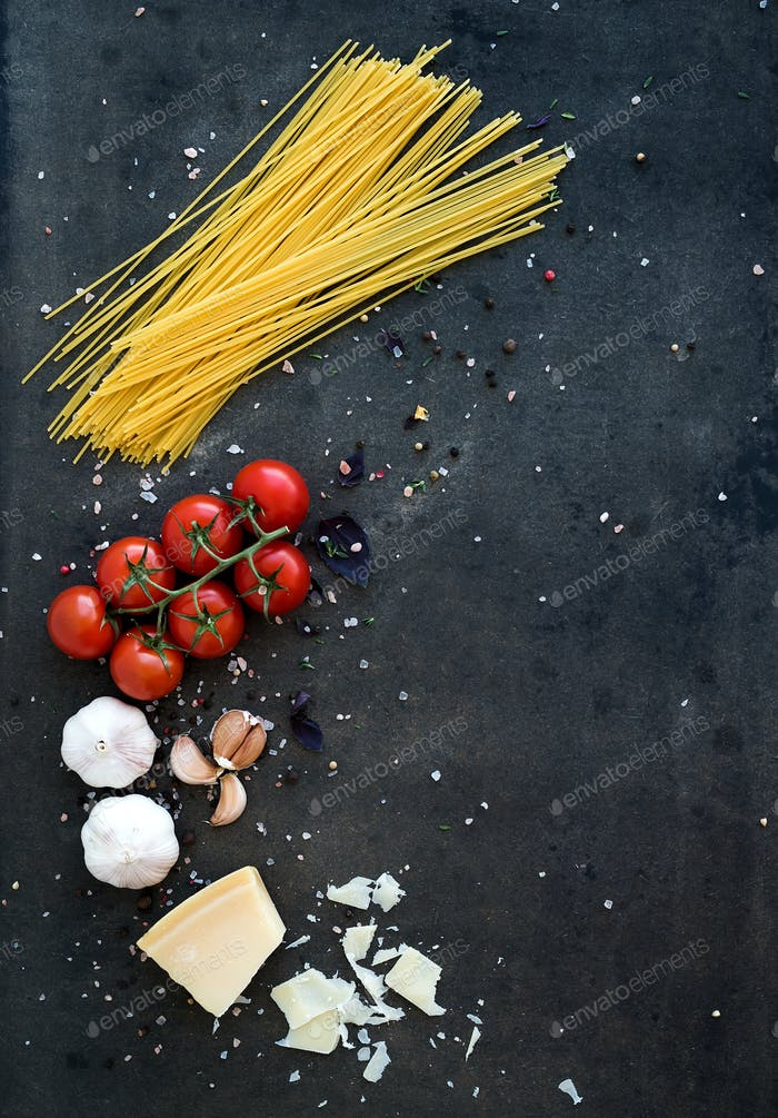 Food frame. Pasta ingredients. Cherry-tomatoes, spaghetti pasta