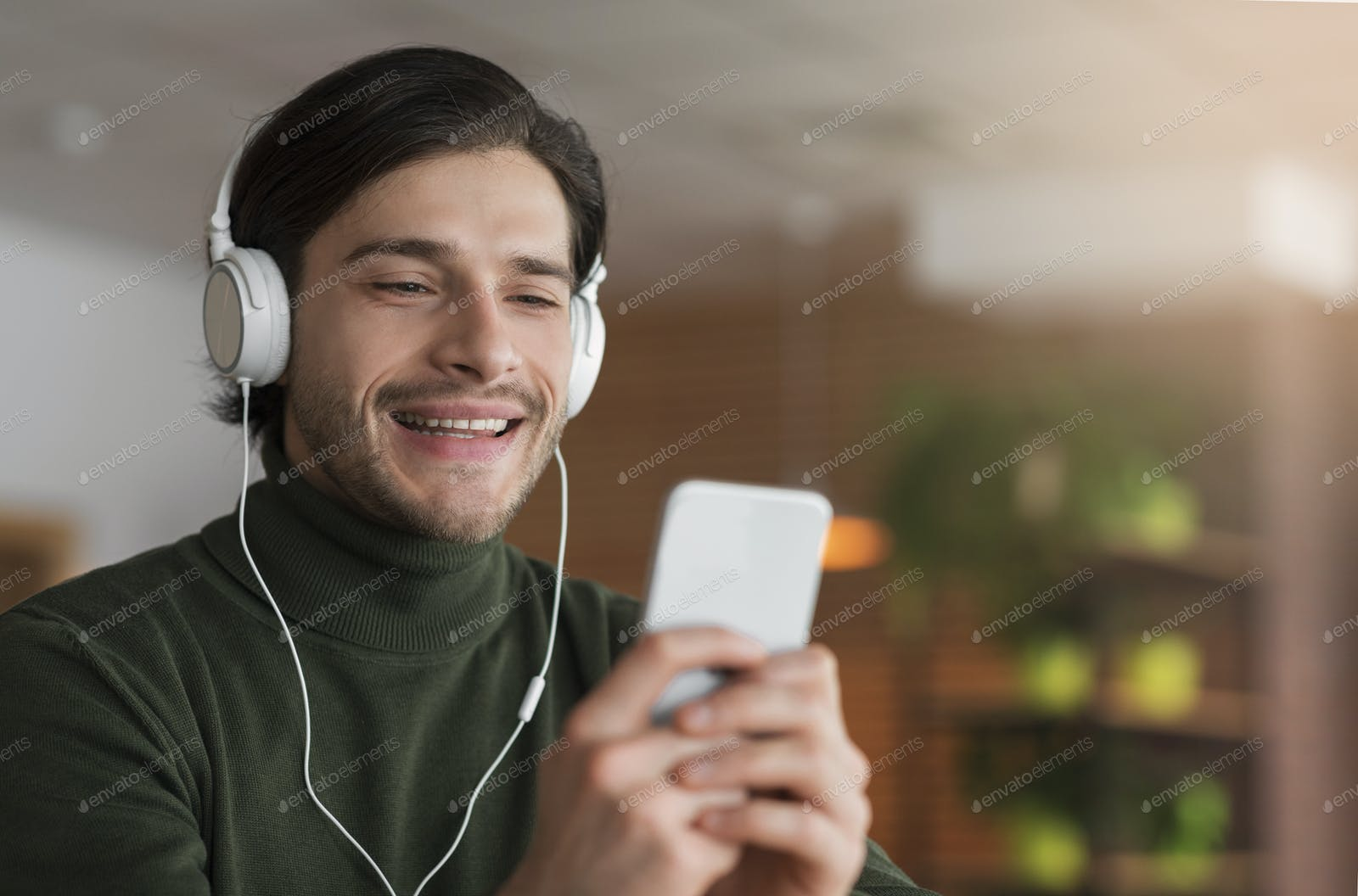 Cheerful Guy In Headset Having Video Call Using Phone Photo By Prostock Studio On Envato Elements