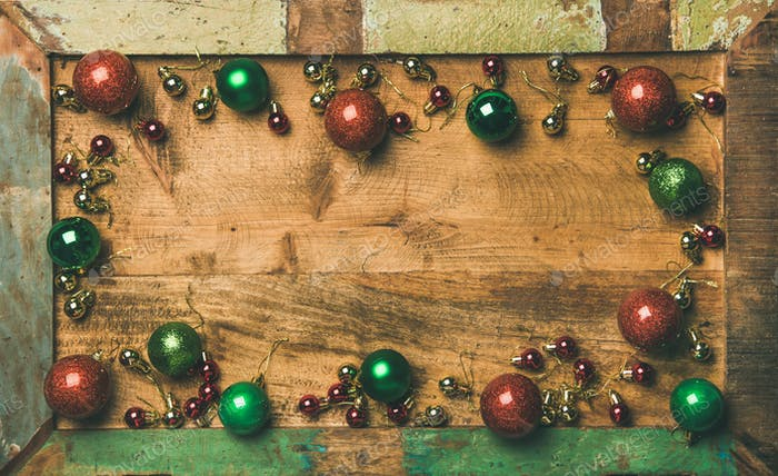 Christmas tree decoration balls on wooden tray background