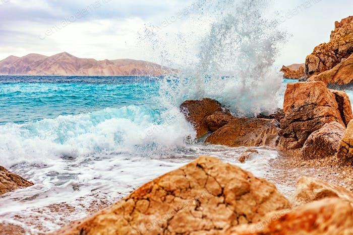 Storm on the tropical sea, crashing waves on rocks
