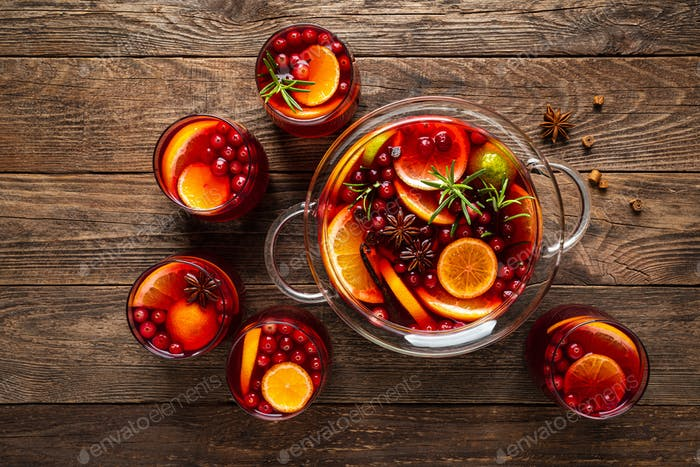 Christmas punch. Festive red cocktail, drink with cranberries and citrus fruits in a punch bowl