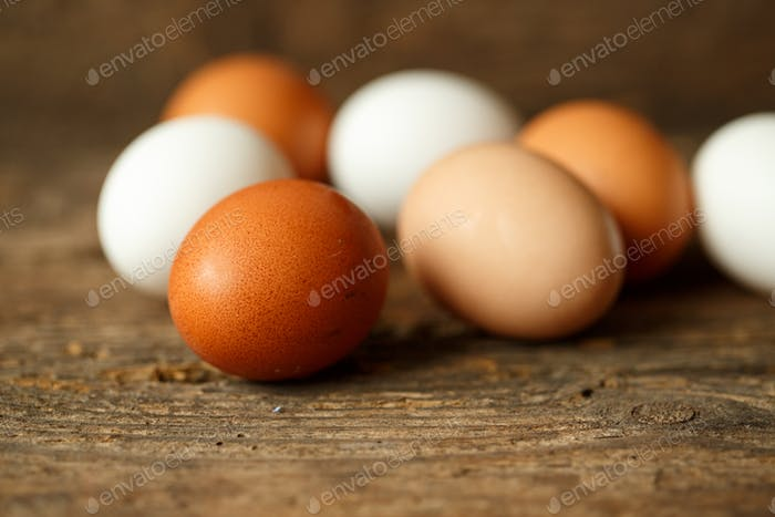 Chicken eggs on a wooden rustic background