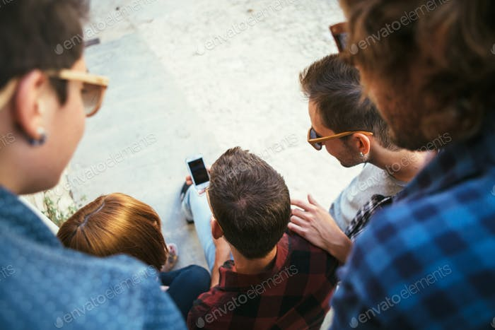Back view of people watching phone