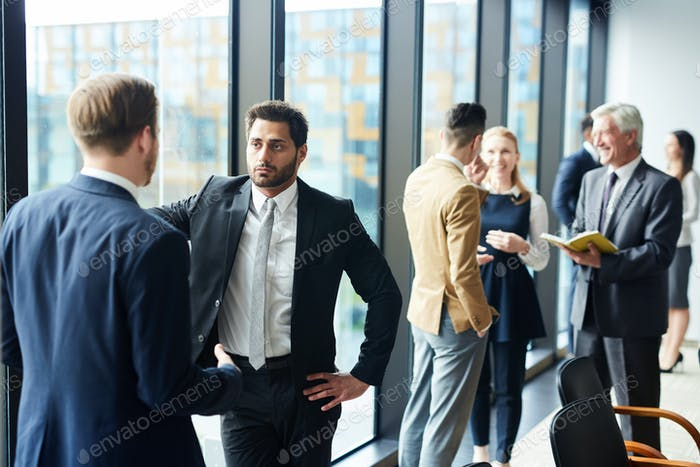 Men discussing working moments