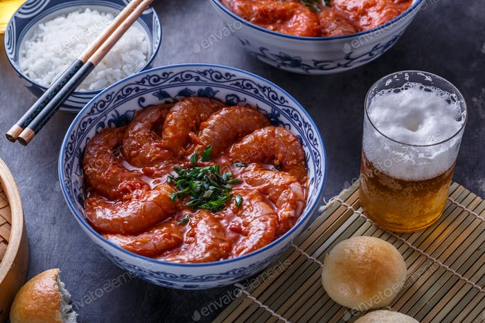 Close view of bowl with big prawn in hot sauce with beer, asian cuisine