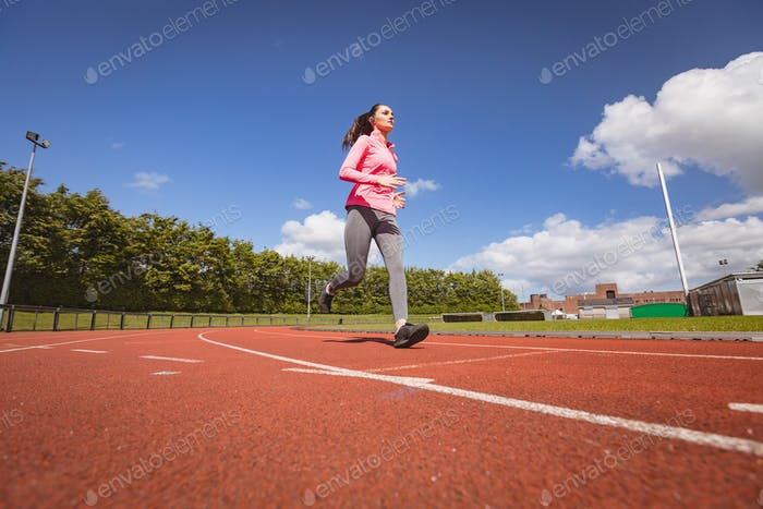 Woman jogging on a race track