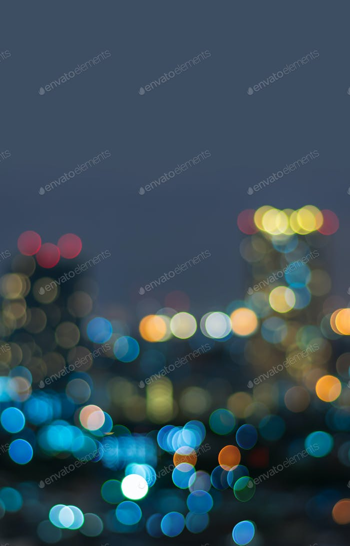 Vertical cover of blurred bokeh cityscape at twilight time, city background,