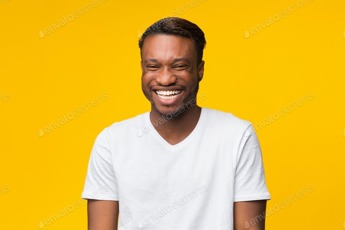 Funny Afro Man Laughing Looking At Camera Standing, Yellow Background