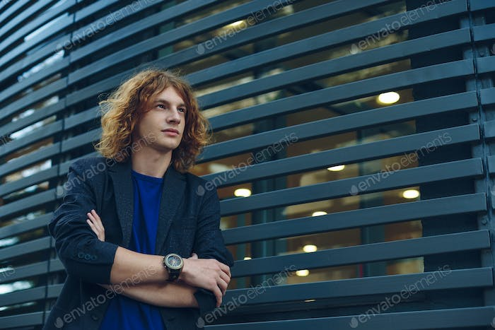 Model man with reddish curly hair
