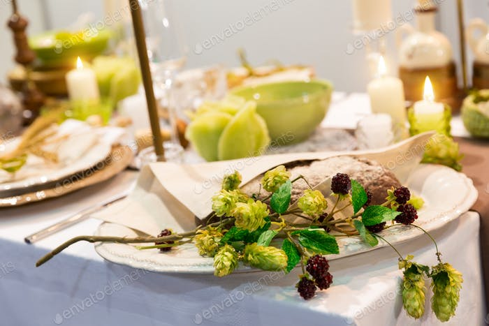 Festive table with candles and flowers closeup