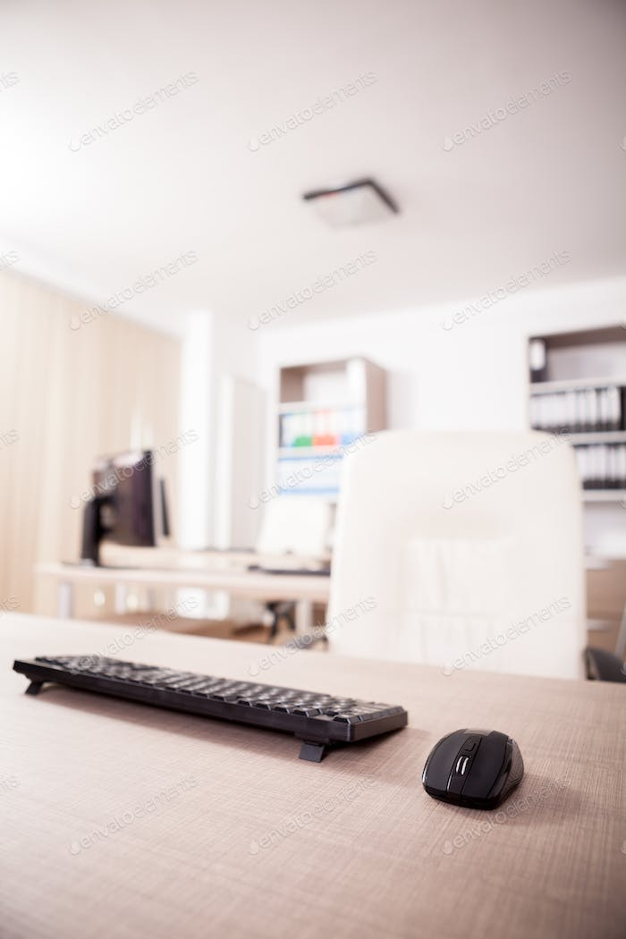 Close up on mouse and keyboard in modern empty office