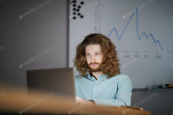 Businessman Working in Dark