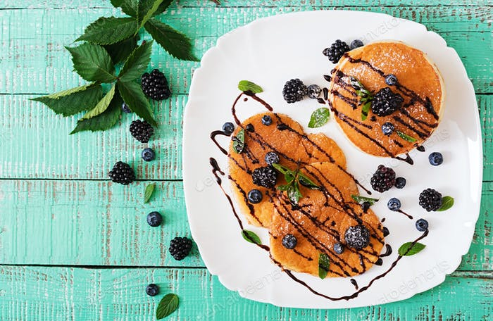 Delicious pancakes with blackberries and chocolate. Top view