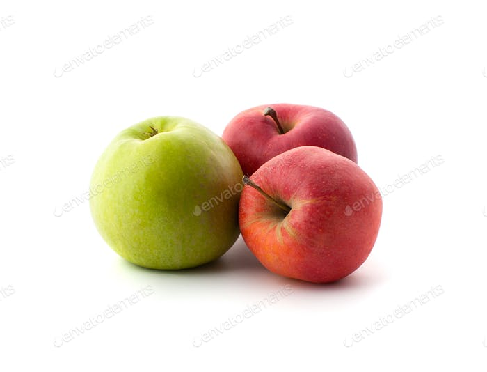 Two red and one green ripe apples on a white background.