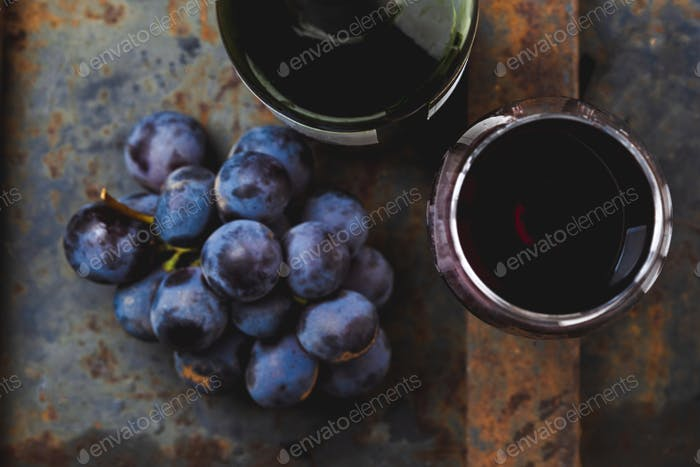 Wine concept - wine, grape on rustik dark background. Top wiew