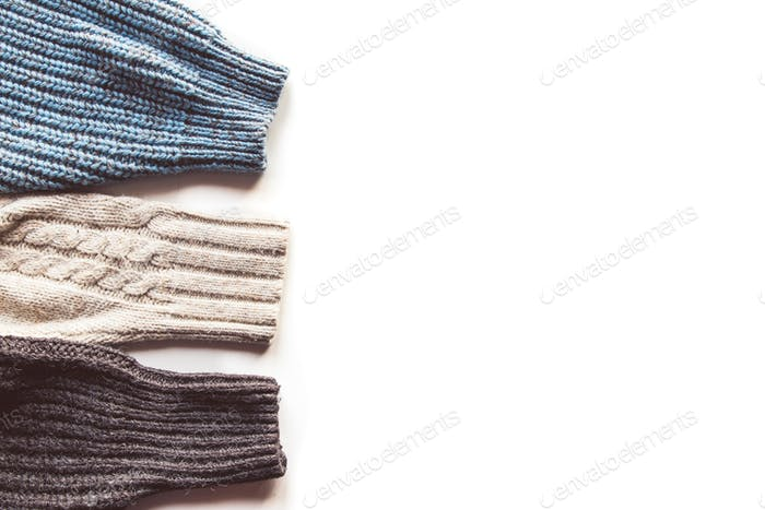 Warm knitted sleeve from a sweater with a pattern. Isolate on white
