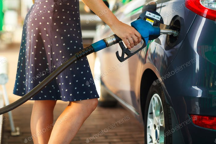 Woman fills petrol into her car