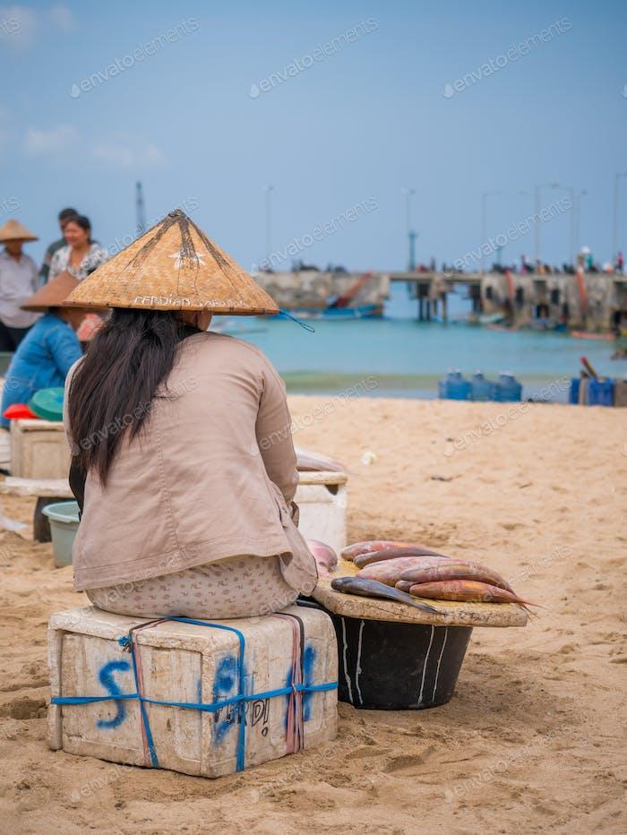 Fishermen work in the fishing village of Jimbara , BALI
