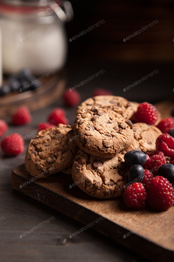 Delicious chocolate cookies for breakfast with milk and blueberries