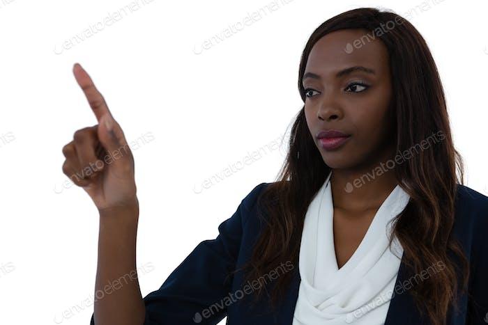 Confident businesswoman gesturing on imaginary screen