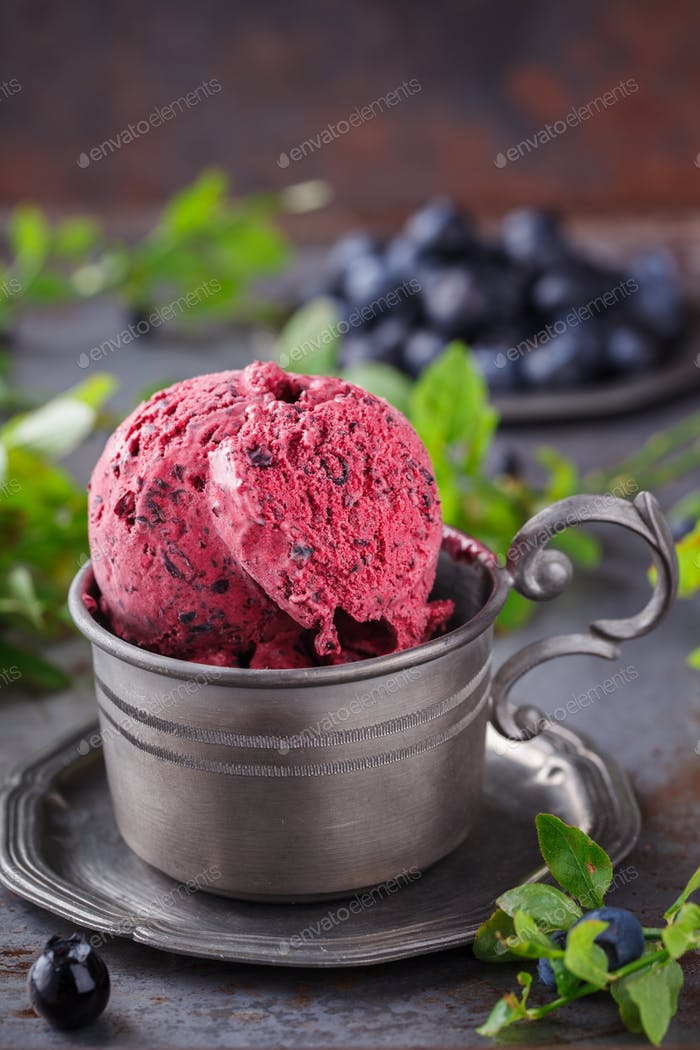 Ice cream with blueberries in a vintage metal ware.Summer dessert concept