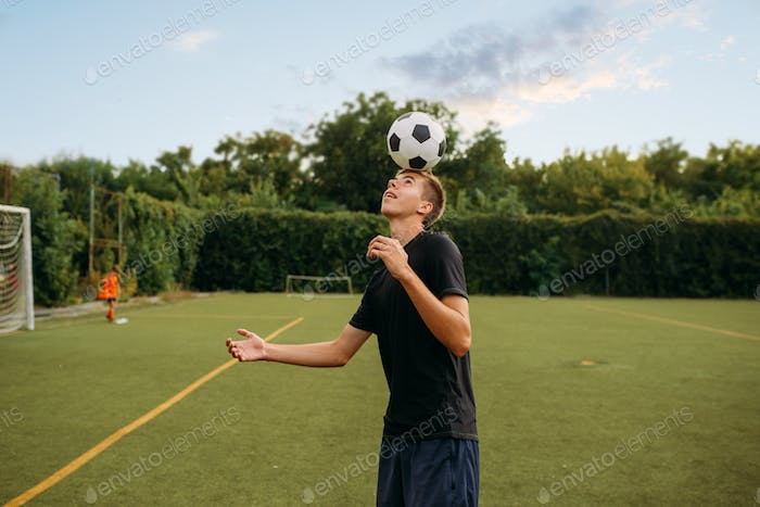 Male soccer player stuffs the ball with his head