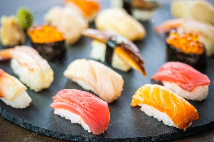 Nigiri sushi set with salmon tuna shrimp prawn eel shell and oth