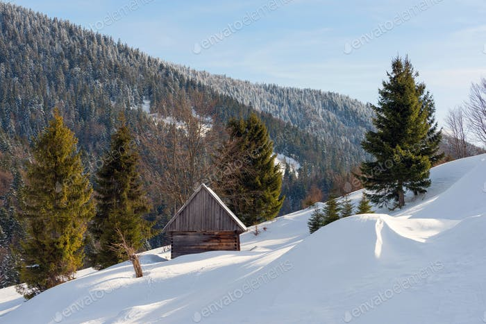 Old wooden house in the winter