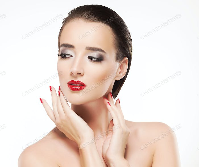 Beauty Woman with Perfect Makeup. Beautiful Professional Holiday Make-up. Red Pink Lips and Nails.