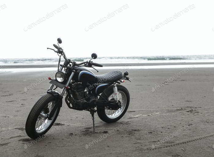 Motorcycle at sunset on a sandy beach
