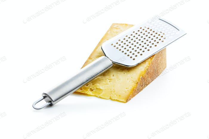 Tasty cheese block and cheese grater.