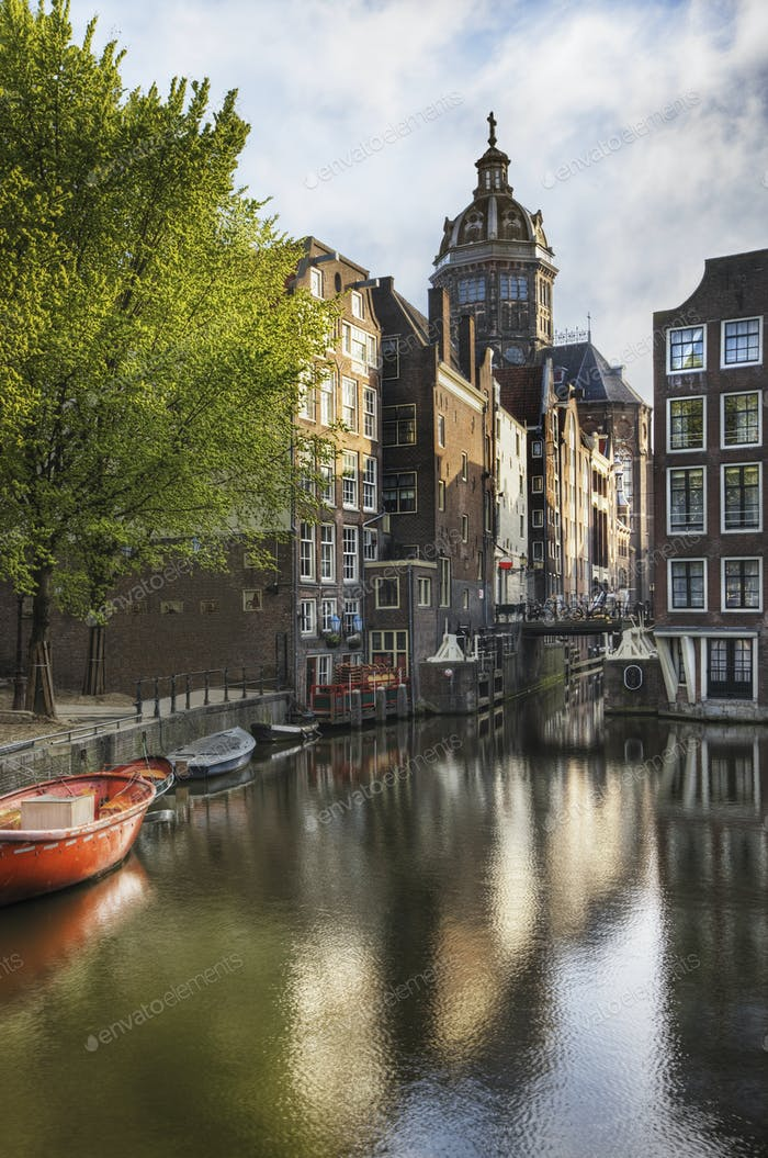 Historic Buildings and Canal in Amsterdam