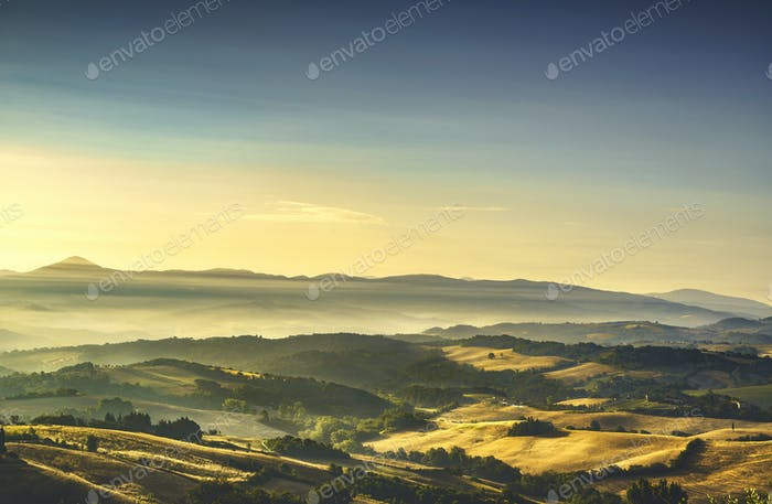 Tuscany Maremma foggy morning, farmlands and green fields. Italy
