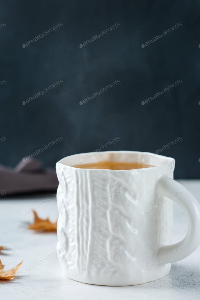 Big white mug with hot tea for cold days