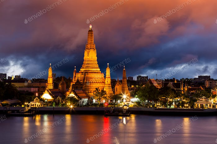 Wat Arun, at Chao Phraya river at sunset, Bangkok, Thailand.