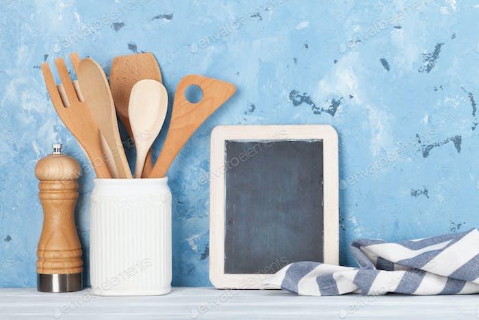 Kitchen utensils and chalkboard