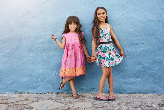 Two little girls standing together