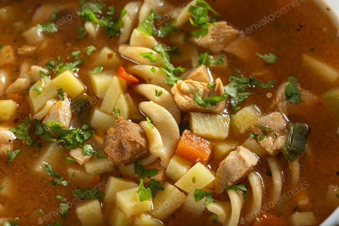 Soup with fusilli, chicken meat and vegetables