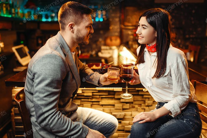 Love couple relaxing with alcohol at bar counter