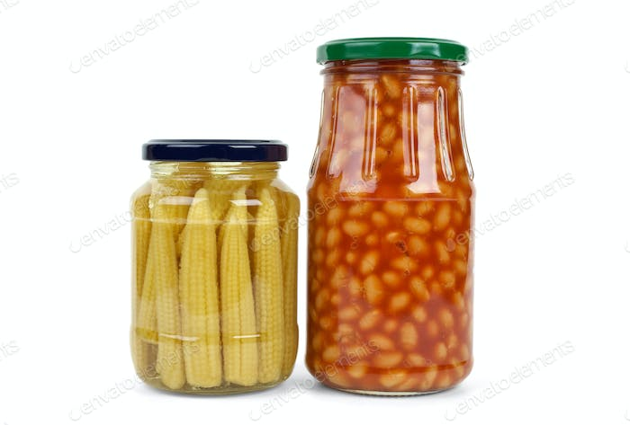 Glass jars with marinated corn ears and harricot beans