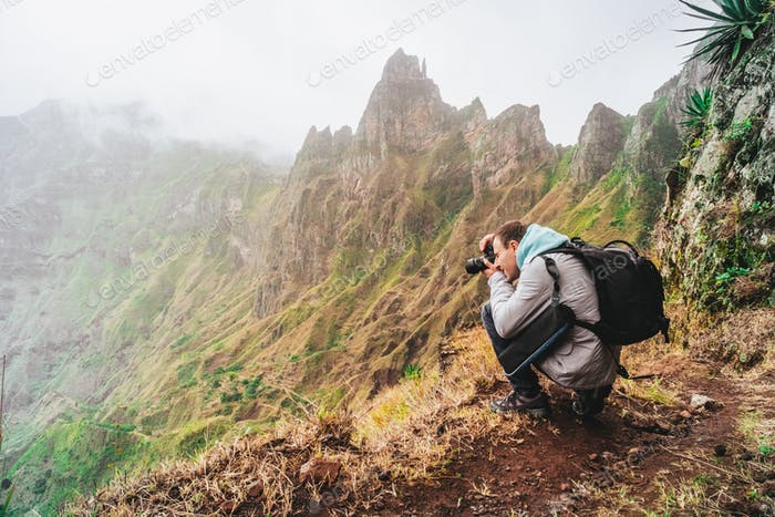 Santo Antao Island, Cape Verde. Hiking outdoor activity. Male traveler photographing mountain peaks