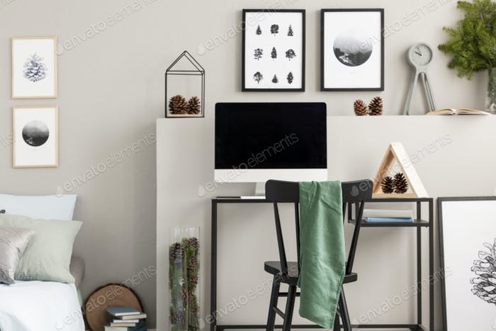 Cones on shelf above desk with all in one computer