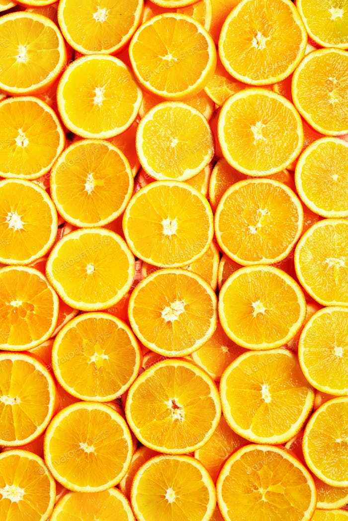 Creative pattern. Fresh sliced orange fruit texture. Macro, top view with copy space. Food frame