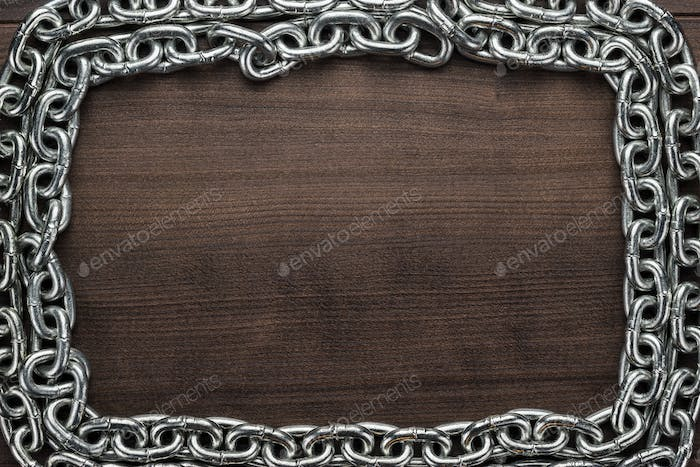 Chain Frame On The Wooden Background